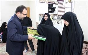 پرچم متبرک حرم امام هشتم، میهمان خانواده شهید قنبریان