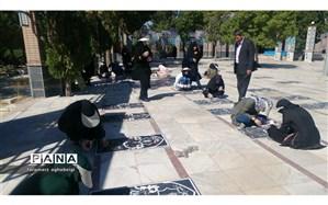 تنظیف و ترمیم قبور مطهر شهدا در تربت حیدریه به همت بسیج دانش آموزی