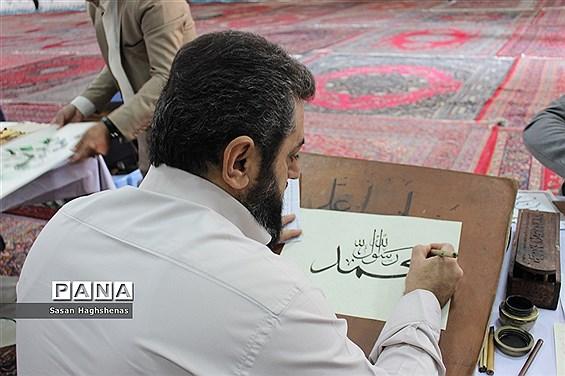 کتابت سوره مبارک محمد(ص)در مصلی نماز جمعه شهرستان اسلامشهر