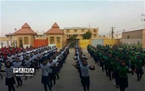 برگزاری ورزش و نرمش صبحگاهی در دبیرستان دخترانه شهید ابوالحسنی شهرستان امیدیه
