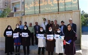 کاشت نهال در محوطه درمانگاه فرهنگیان شهرستان دشتستان