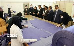 تولید روزانه ۶۵۰ دست لباس یک بار مصرف پزشکی در هنرستان های فنی و حرفه ای و کار دانش استان کرمان