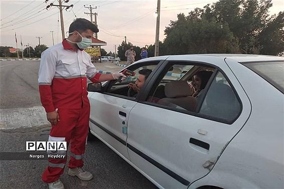 کنترل ورودی های  شهرستان امیدیه توسط  قرارگاه غربالگری کرونا ویروس پدافند زیستی شفا