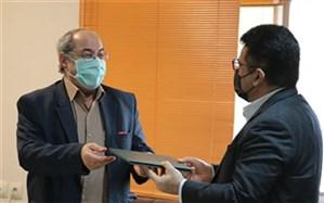 تقدیر پیشکسوت رسانهای استان بوشهر از مدافعان سلامت دانشگاه علوم پزشکی