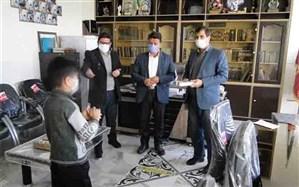اهدا دو دستگاه تبلت به دانش آموزان بن رودی