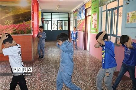 مانور سراسری زلزله در دبستان شهید عاشوری بوشهر |